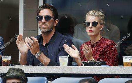 New York Rangers goalie Henrik Lundqvist (L) and his wife Therese Andersson (R) watch as Juan Martin del Potro of Argentina plays Rafal Nadal of Spain in their semi-final match on the twelfth day of the US Open Tennis Championships the USTA National Tennis Center in Flushing Meadows, New York, USA, 07 September 2018. The US Open runs from 27 August through 09 September.