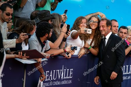French actor Vincent Lindon (R) poses for fans as he arrives on the red carpet prior to the premiere of 'Line of Fire' during the 44th Deauville American Film Festival, in Deauville, France, 07 September 2018. The festival runs from 31 August to 11 September.