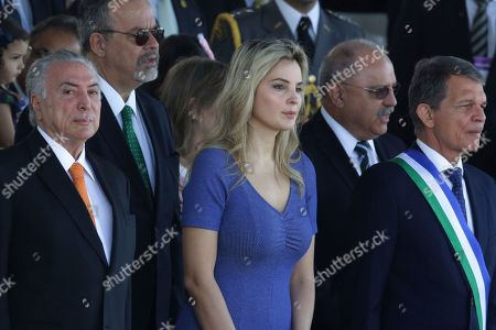 """Michel Temer, Marcela Temer. Brazil's President Michel Temer, left, and his wife Marcela, watch an Independence Day military parade in Brasilia, Brazil, . The South American country is celebrating it's Sept. 7, 1822 declaration of independence from Portugal commonly known as """"Sete de Setembro"""