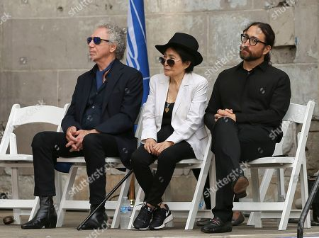 Photographer Bob Gruen, from left, Yoko Ono and Sean Lennon listen to remarks during a ceremony dedicating the new John Lennon Commemorative Forever stamp by the United States Postal Service, in New York