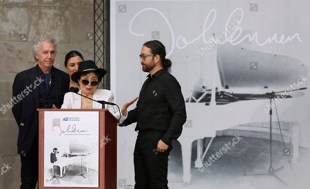 Yoko Ono speaks as her son Sean Lennon, right, and photographer Bob Gruen look on during a ceremony dedicating the John Lennon Commemorative Forever stamp by the United States Postal Service, in New York
