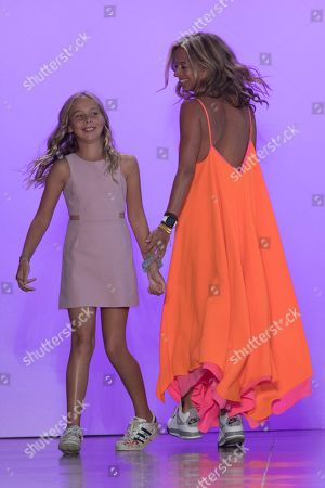Michelle Smith, Sophia Smith. Designer Michelle Smith, right, and her daughter Sophia Smith appear on the runway at the end of the Milly spring 2019 collection presentation during Fashion Week in New York