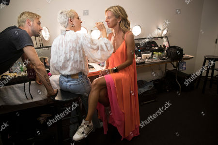 Designer Michelle Smith, right, has her make up done backstage ahead of the Milly spring 2019 collection presentation during Fashion Week in New York