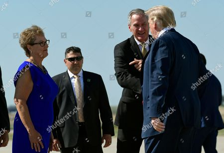 Donald Trump, Dennis Daugaard, Linda Daugaard. President Donald Trump, right, is greeted by South Dakota Gov. Dennis Daugaard, second from right, and wife Linda Daugaard, left, after arriving at Sioux Falls Regional Airport, in Sioux Falls, S.D., . Trump is in Sioux Falls to speak at the Noem-Rhoden Victory Committee, a joint fundraising committee authorized by and composed of Kristi Noem for Governor, Larry Rhoden for Lieutenant Governor, KRISTI PAC and the South Dakota Republican Party