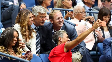 Alec Baldwin poses for a selfie taken by USTA President Katrina Adams