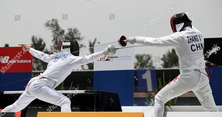 Xiao Nan Zhang (R) from China competes with Anastasiya Prokopenko (L) from Belarus, during the women's relay fencing competition that takes place in the framework of the Modern Pentathlon World Championship in Mexico City, Mexico, 07 September 2018.