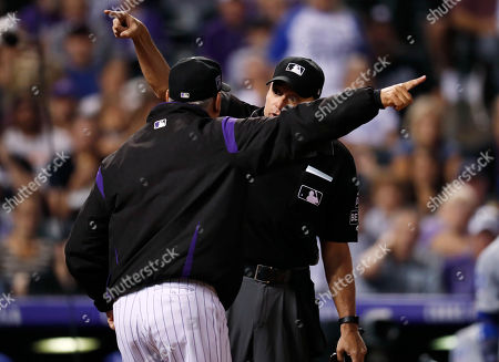 Bud black, andy fletcher, bud black. Colorado Rockies manager Bud Black, front, argues with home plate umpire Andy Fletcher after he called a balk against Rockies relief pitcher Chris Rusin while facing the Los Angeles Dodgers in the fifth inning of a baseball game, in Denver