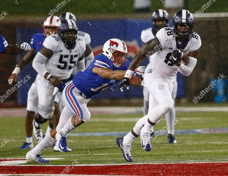 TCU tight end Artayvious Lynn (88) tries to get away form SMU linebacker Richard Moore (14) after a reception during the second quarter of an NCAA college football game, in Dallas