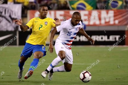 United States midfielder Julian Green, right, controls the ball as Brazil forward Douglas Acosta defends during the first half of an international soccer friendly match, in East Rutherford, N.J