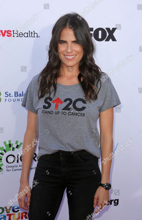 Karla Souza arrives at the 2018 Stand Up To Cancer event at the Barker Hangar at the Santa Monica airport, in Santa Monica, Calif