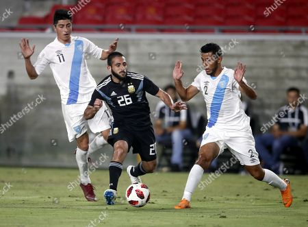 Argentinian player Matias Vargas (C) in action against  Guatemalan players Cristian Jimenez (R) and Frank De Leon (L) in the second half of their international friendly match at the Los Angeles Coliseum in Los Angeles, California, USA, 07 September 2018.  Argentina won the game.