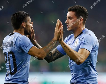 Stock Image of Uruguay player Jose Maria Gimenez (R) celebrates a goal with teammate Jonathan Urretaviscaya (L) against Mexico in the first half of the friendly soccer match between Mexico and Uruguay at NRG Stadium in Houston,Texas, USA, 07 September 2018.