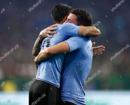 Uruguay player Jose Maria Gimenez (R) celebrates a goal with teammate Jonathan Urretaviscaya (L) against Mexico in the first half of the friendly soccer match between Mexico and Uruguay at NRG Stadium in Houston,Texas, USA, 07 September 2018.