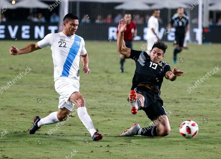 Guatemala defender Carlos Gallardo, left, tries to get the ball past Argentina forward Giovanni Simeone during the second half of an international friendly soccer match in Los Angeles, . Argentina won 3-0
