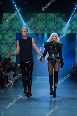 Phillipe Blond, David Blond. Designers David, left, and Phillipe Blond appear following the presentation of The Blonds spring 2019 collection with a Disney villains theme during Fashion Week, in New York