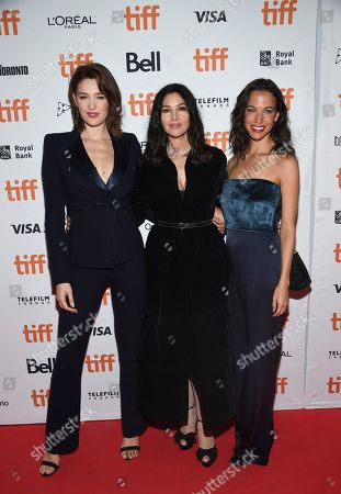 """Stock Photo of Tess Haubrich, Monica Bellucci, Caroline Ford. Actors Tess Haubrich, left, Monica Bellucci and Caroline Ford attend the premiere for """"Nekrotronic"""" on day 2 of the Toronto International Film Festival, at the Ryerson Theatre, in Toronto"""