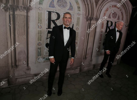 Andy Cohen, Anderson Cooper. Andy Cohen, left, and Anderson Cooper attend the Ralph Lauren 50th Anniversary Event held at Bethesda Terrace in Central Park during New York Fashion Week, in New York