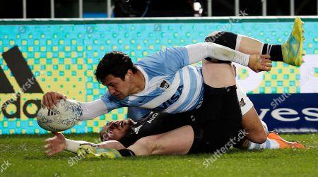 All Blacks TJ Perenara, bottom, stops Pumas Marcelo Bosch from scoring a try at Trafalgar Park in Nelson, New Zealand