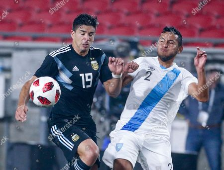 Stock Picture of Argentina forwrad Giovanni Simeone (19) and Guatemala defender Cristian Jimenez (2) in action during an international friendly soccer match in Los Angeles, . Argentina won 3-0