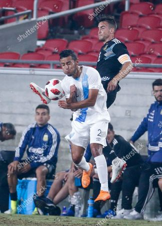 Guatemala defender Cristian Jimenez (2) and Argentina defender Nicolas Tafliafico (3) in action during an international friendly soccer match in Los Angeles, . Argentina won 3-0