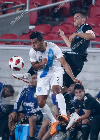 Stock Photo of Guatemala defender Cristian Jimenez (2) and Argentina defender Nicolas Tafliafico (3) in action during an international friendly soccer match in Los Angeles, . Argentina won 3-0