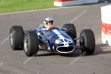 Stock Picture of Derek Bell pictured driving the Eagle F1 Car at the Goodwood Revival with a mixed set of weather forecast this weekend.