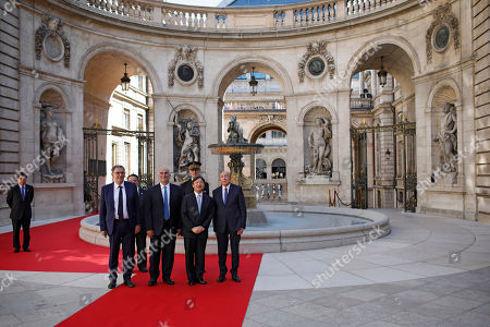 Japan's Crown Prince Naruhito, second right, poses with French Interior Minister Gerard Collomb, right, Lyon Metropolitan President David Kimelfeld, left, and Lyon's mayor Georges Kepenekian, second left, as they arrive at Lyon's city hall, central France, . Japan's Crown Prince Naruhito is on a nine-day goodwill visit to France