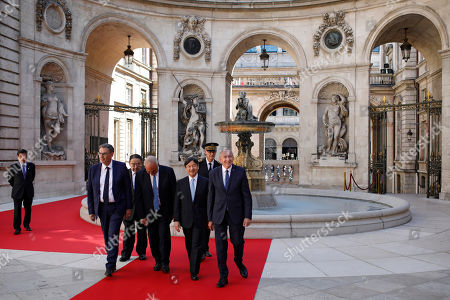 Japan's Crown Prince Naruhito, second right, arrives with French Interior Minister Gerard Collomb, right, Lyon Metropolitan President David Kimelfeld, left, and Lyon's mayor Georges Kepenekian, second left, at Lyon's city hall, central France, . Japan's Crown Prince Naruhito is on a nine-day goodwill visit in France