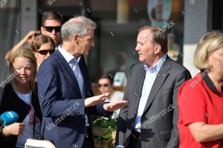 Stefan Lofven (R), leader of the Swedish Social Democratic Party, speaks to his counterpart in Norway, Jonas Gahr Store (L), during an election rally in central Stockholm, Sweden, 08 September 2018. Sweden's general elections will be held on 09 September.