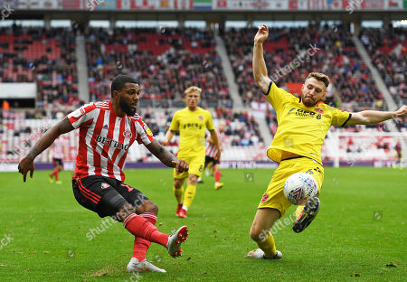Stock Photo of Tommy Spurr of Fleetwood Town tries to blocks a pass from Jerome Sinclair of Sunderland