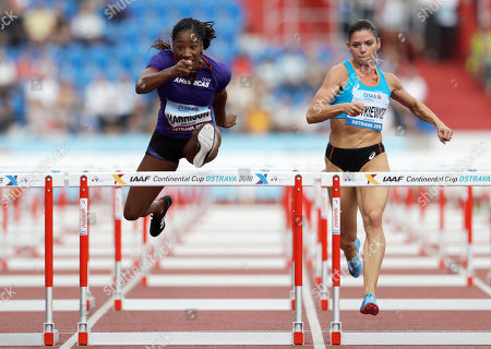 Stock Photo of Kendra Harrison of the U.S., left, and Pamela Dutkiewicz of Germany compete in the women's 100 metres hurdles for the Americas for Europe at the IAAF track and field Continental Cup in Ostrava, Czech Republic