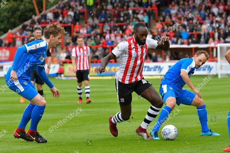 Hiram Boateng (44) of Exeter City battles for possession with David Vaughan (8) of Notts County during the EFL Sky Bet League 2 match between Exeter City and Notts County at St James' Park, Exeter