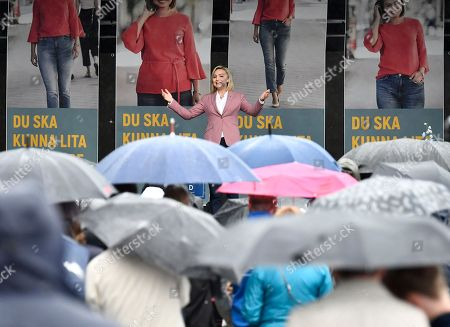 Ebba Busch Thor (C, background), leader of the Swedish Christian Democrats, speaks to people braving the rain during an election campaign rally in Gothenburg, Sweden, 08 September 2018. Sweden's general elections will be held on 09 September.