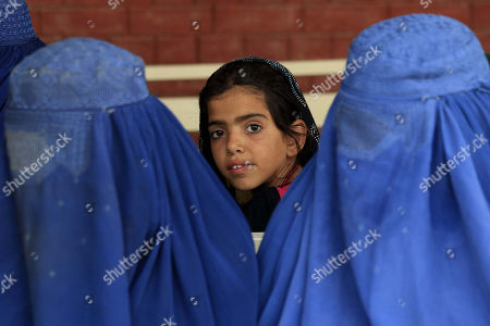 An Afghan Refugee Girl Poses For A Photograph As She Waits To Leave With  His Family ...
