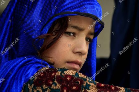 Afghan Refugee Girl Waits To Get Registered At A United Nation High  Commissioner For Refugees ...