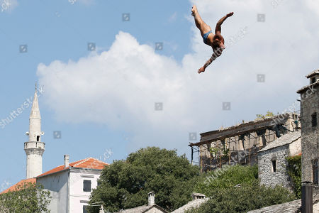 Bosnia Red Bull Cliff Diving World Series 2018. A diver Alessandro De Rose, of Italy jumps from the Old Mostar Bridge during the Red Bull Cliff Diving World Series competition in Mostar, 140 kms south of Bosnian capital of Sarajevo, . Twenty four people are competing from the 28 meter high bridge over the river of Neretva. Gary Hunt from UK took first place in male category and Adriana Jimenez from Mexico took first place in female category