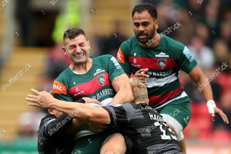 Jonny May of Leicester Tigers is tackled by Toby Flood and Chris Harris of Newcastle Falcons