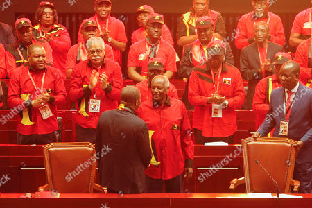 The outgoing president of the Popular Movement for the Liberation of Angola (MPLA) Jose Eduardo dos Santos (C) shakes hand with the new President Joao Lourenco (C-L) during the 6th MPLA Extraordinary Congress held in the Belas Complex, south of Luanda, Angola, 08 September 2018. Former President of Angola, Jose Eduardo dos Santos, ended his career in active politics on the same day, handing over power to the Popular Movement for the Liberation of Angola (MPLA) to current Angolan head of state, Joao Lourenco.