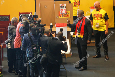 The new president of the Popular Movement for the Liberation of Angola (MPLA) Joao Lourenco (2-R) shows his painted finger after pulling his vote during the 6th MPLA Extraordinary Congress held in the Belas Complex, south of Luanda, Angola, 08 September 2018. Former President of Angola, Jose Eduardo dos Santos, ended his career in active politics on the same day, handing over power to the Popular Movement for the Liberation of Angola (MPLA) to current Angolan head of state, Joao Lourenco.