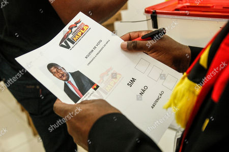 A delegate of the Popular Movement for the Liberation of Angola (MPLA) holds a vote sheet during the 6th MPLA Extraordinary Congress held in the Belas Complex, south of Luanda, Angola, 08 September 2018. Former President of Angola, Jose Eduardo dos Santos, ended his career in active politics on the same day, handing over power to the Popular Movement for the Liberation of Angola (MPLA) to current Angolan head of state, Joao Lourenco.