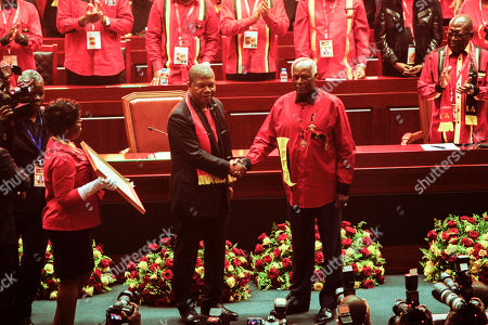 Outgoing president of the Popular Movement for the Liberation of Angola (MPLA) Jose Eduardo dos Santos (R) shakes hand with the new President Joao Lourenco (L) after he won the internal election during the 6th MPLA Extraordinary Congress held in the Belas Complex, south of Luanda, Angola, 08 September 2018. Former President of Angola, Jose Eduardo dos Santos, ended his career in active politics on the same day, handing over power to the Popular Movement for the Liberation of Angola (MPLA) to current Angolan head of state, Joao Lourenco.