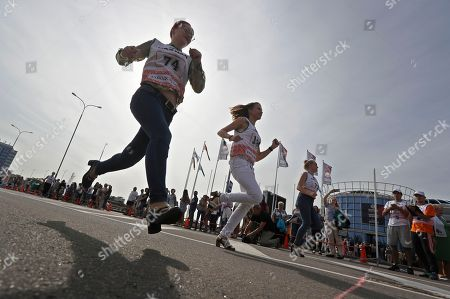Competitors Run During The High Heels Race In Minsk, Belarus, On .