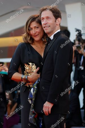 Tim Blake Nelson, Lisa Benavides. Actor Tim Blake Nelson, right, and Lisa Benavides pose for photographers upon arrival at the closing ceremony of the 75th edition of the Venice Film Festival in Venice, Italy