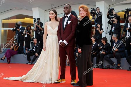 Jennifer Kent, Baykali Ganambarr, Aisling Franciosi. Director Jennifer Kent, from right, actors and Baykali Ganambarr and Aisling Franciosi pose for photographers upon arrival at the closing ceremony of the 75th edition of the Venice Film Festival in Venice, Italy