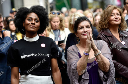 Somkele Iyamah-Idhalama, Nancy Puetz. Actress Somkele Iyamah-Idhalama, left, and Nancy Puetz, vice president of Women in Film & Television International, react to stage remarks during the Share Her Journey Rally for Women in Film during the Toronto Film Festival,, in Toronto