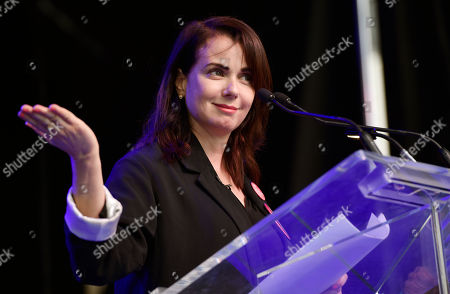 Mia Kirshner addresses the crowd at the Share Her Journey Rally for Women in Film during the Toronto International Film Festival,, in Toronto