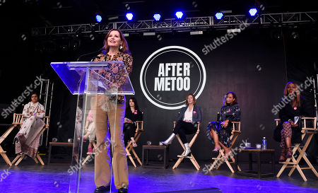Stock Image of Geena Davis addresses the crowd at the Share Her Journey Rally for Women in Film during the Toronto Film Festival,, in Toronto. From left behind Davis are filmmaker Nandita Das, actress Mia Kirshner, Sundance Institute executive director Keri Putnam, actress Amanda Brugel and filmmaker Amma Asante