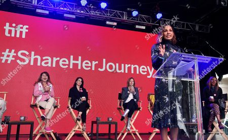 Amanda Brugel, Stacy Smith, Mia Kirshner, Keri Putnam, Amma Asante. Actress Amanda Brugel addresses the crowd during the Share Her Journey Rally for Women in Film during the Toronto International Film Festival,, in Toronto. From left behind Brugel are Dr. Stacy L. Smith, founder and director of the USC Annenberg Inclusion Initiative, actress Mia Kirshner, Sundance Institute executive director Keri Putnam and filmmaker Amma Asante