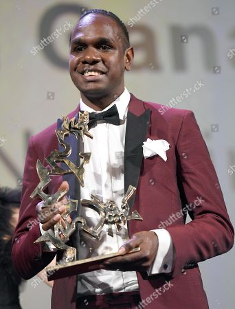 Australian actor Baykali Ganambarr holds his Marcello Mastroianni Award for young performer for the movie 'The Nightingale' during the awarding ceremony of the 75th annual Venice International Film Festival, in Venice, Italy, 08 September 2018. The festival runs from 29 August to 08 September.