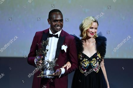Australian actor Baykali Ganambarr (L) stands on stage next to jury member and Australian actress Naomi Watts, as he holds his Marcello Mastroianni Award for young performer for the movie 'The Nightingale' during the awarding ceremony of the 75th annual Venice International Film Festival, in Venice, Italy, 08 September 2018. The festival runs from 29 August to 08 September.
